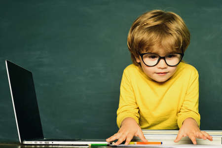 Little children at school lesson. Ready for school. Preschooler. Blackboard copy space. First school day. Schoolboy. School kids. Schoolboy.