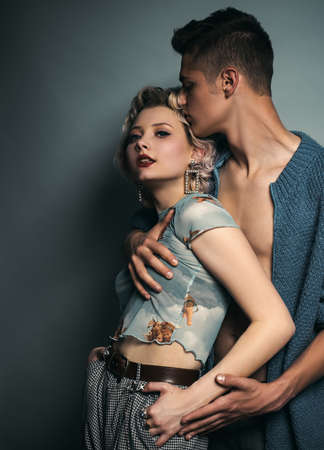 Hipsters love. Rock style. Fashion studio photo of beautiful sensual couple posing together.Love. Handsome young lovers.