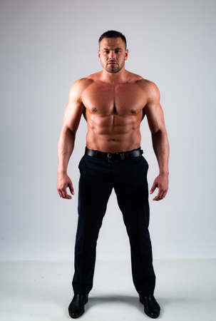 Muscular guy with torso. Full length.