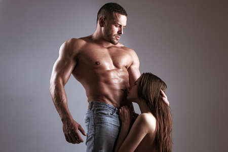 Sensual couple kiss. Couple In Love. Romantic and love concept. Hugs together and sensual touch. Sexually explicit. Passionate lover caressing arousing beautiful woman. Dominant man. Loving people.