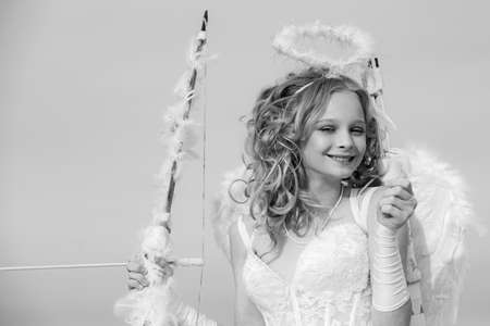 Valentine Day Gift Card - Holiday teen Cupid with Love. Innocent girl. Concept of Valentines Daygirl dressed as an angel on a light background