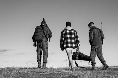 Hunters with shotgun gun on hunt. Hunting Gear - Hunting Supplies and Equipment. Hunting without borders.