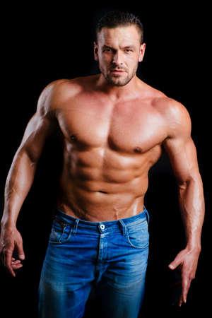 Shirtless athletic guy. Sexy muscular man.