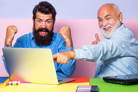Office workers screaming with laughter and can not stop with funny emotions. Crazy manager having friendly conversation at meeting with laptop.