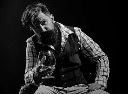 Alcoholism and alcohol addiction and people concept. Stop alcohol addiction. Bearded handsome man holding glass of whiskey. Diverse young people.