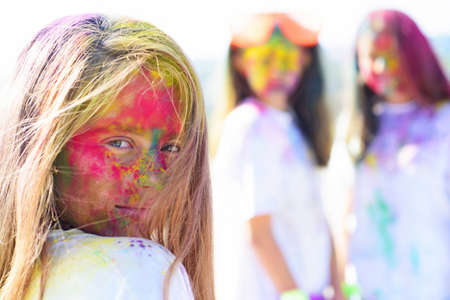 positive and cheerful. colorful neon paint makeup. children with creative body art. fashion youth party. Optimist. Spring vibes. Crazy hipster girls. Summer weather. fluorescent make-up