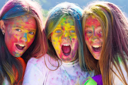 Happy youth party. Optimist. Spring vibes. children with creative body art. Crazy hipster girls. Summer weather. positive and cheerful. colorful neon paint makeup. colorful make up. holi makeup