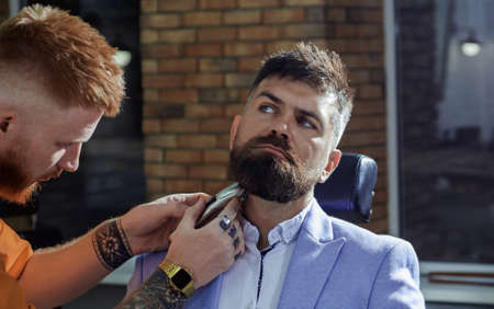 Hair Preparation is just for the dashing chap. Barber - Shaves and Trims. Beard styling and cut. Shaving man and razor man. Hairdressers work for a handsome guy at the barber shop.