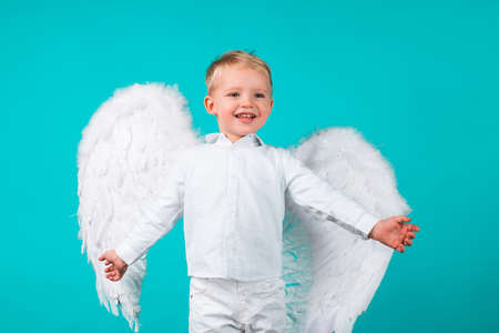 Kids with angel wings. Little cute boy child in angel dress with happy smiling face. Cupid valentin on valentines day. Festive greeting love Card.