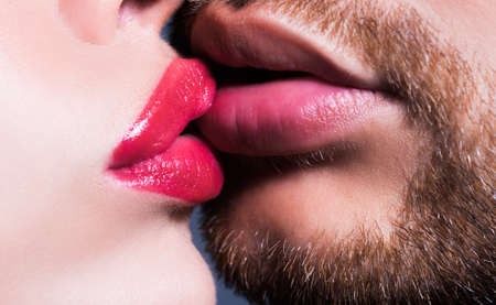 Romantic beautiful lovely couple of lovers kissing. Tongue in lovers mouth, sexy homosexual concept. French Kisses. Sensual kiss close up.