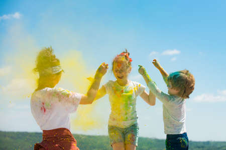 Cute children celebrate Indian holi festival with color. Reklamní fotografie