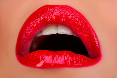 Sexy lip, Open female sensual mouth. Lips with red lipstick.