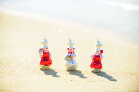 New Year travel. Funny summer snowman. Christmas banner, poster or greeting cards.