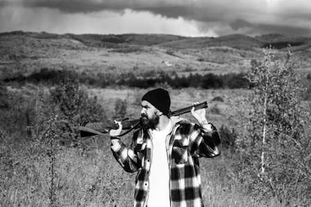 Hunter with shotgun gun on hunt. Autunm hunting. Closed and open hunting season. Hunting Gear and Hunting Clothing. Big game. Stock Photo