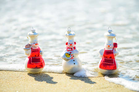 Funny summer Snowman of sand. Holiday concept for New Year and Christmas.