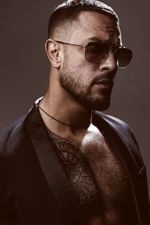 Sexy man face. Imposing guy in glasses. Mens beauty, fashion portrait.