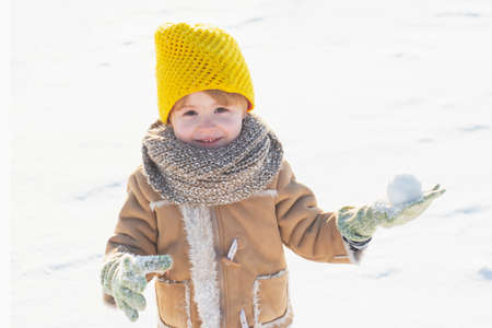 May you have wonderful holiday. Happy new year and merry christmas. Happy winter child snow background. Cute boy in winter clothes hat and scarf close up. Winter fashion. Winter holidays concept