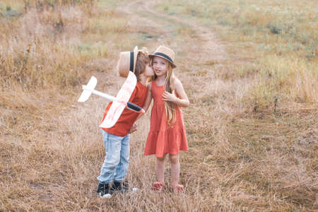 Valentine day. Beautiful little couple - boy and girl embracing. Childhood memories. Romantic and love. Enjoying nice weekend together. Funny kids couple in the autumn park. Stockfoto