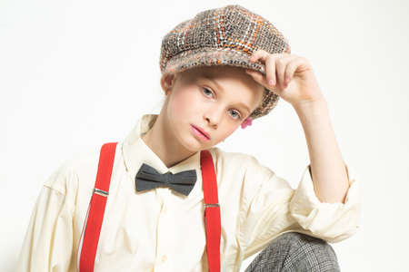 Confident in her style. teen girl in retro suit. suspender and bow tie. old fashioned child in checkered beret. vintage english style. jazz step fashion. retro fashion model. vintage charleston party