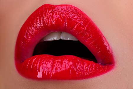 Sexy woman lip, Open female sensual mouth. Lips with red lipstick. Standard-Bild