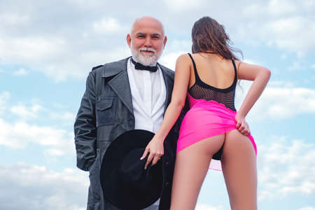 Stripper club. Perfect young girl close up. Senior old man and young woman. Prostitute undressed. Sexy lady with sugar daddy. Senior old man and young woman.