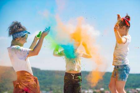 Funny kids in summer. Colored splash powder and color dust. 스톡 콘텐츠