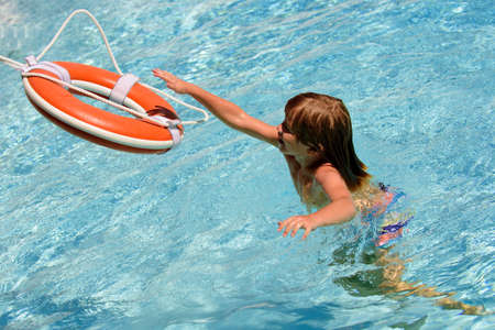 Summer child. Lifebuoy helping to survive boy concept. Support survival or save, rescue. Ring floating in a sea, life preserver. Drown people with rised hand. Foto de archivo