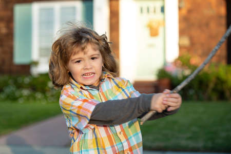 Child aggression. Negative kids emotion. Angry boy with stick. Kid adaptation. Bully. Bullying concept. nervous breakdown.