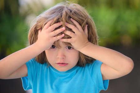 Kids emotions. Confused boy. Negative, nervous breakdown.