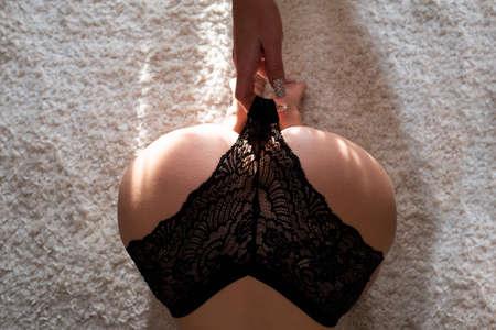 Lesbian girls. Sex touch buttocks. Sexy woman ass. Woman lingerie. Stock Photo