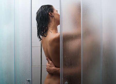 Young couple relaxing in a bathroom and enjoying bath together.