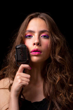 Woman with retro microphone. Closeup girl singer. Concert, sing.