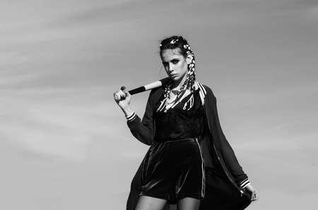 Modern young woman with baseball bat. Young face portrait, female model, beautiful woman