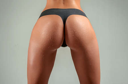 Sexy ass, female butt. Big womans buttocks. Sexy woman in bikini stripper. Perfect young girl in a panties. Fitness form. Woman in underwear.