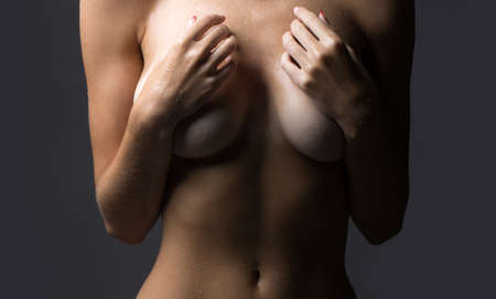 Naked girl slim body. Woman breast. Closeup of female boob. Close up of breast. Woman with big natural boobs.