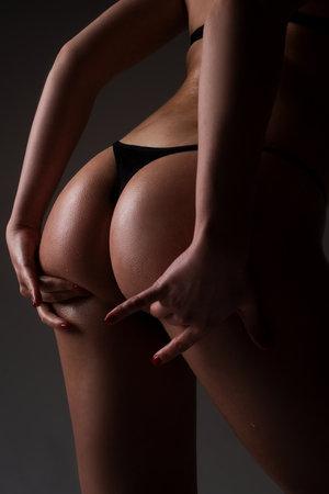 Sexy female body. Women lingerie. Woman panties. Nude girl butt buttocks. Black bikini underwear. Topless female body with big ass. Standard-Bild