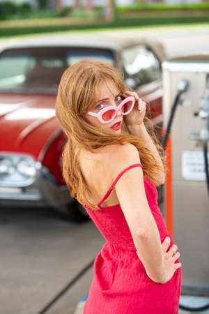 American vintage cars. Old auto. Sensual woman retro automobile.
