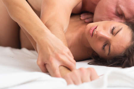 Kissing couple in bed. Couple sex. Sensual seductive desire. Young lovers. Kamasutra positions. Erotic moments.