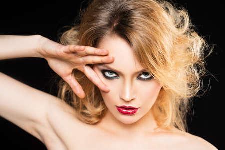 Sexy woman with fashion makeup. Visage, beauty salon, cosmetics. Smokey eyes make up.