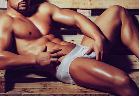 Gay man, muscular boy with muscle torso, Nude body with underpants. Stock Photo