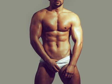 Sexy body. Naked young man. Hot macho. Athletic man body. Stockfoto