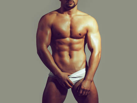 Sexy body. Naked young man. Hot macho. Athletic man body. Stock Photo
