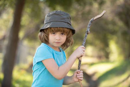 Child aggression. Negative kids emotion. Angry boy with stick. Kid adaptation. Bully. Bullying concept. nervous breakdown