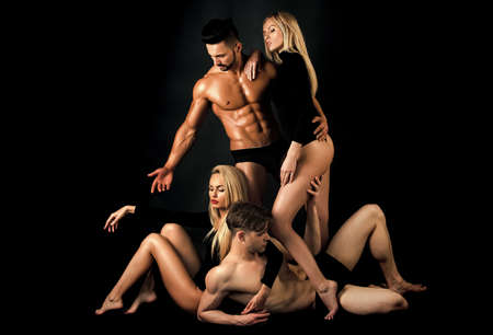 Sensual love game. Group of men with muscular body and twins, relations. People having group together. Love triangle and romance. Swinger relax. Polygamy friends. Fashion people.