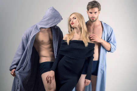 Intimacy and intimate relationship. Love triangle of intimate friends. Sensual woman and men having intimate relations threesome. Friends and intimate frienship Foto de archivo