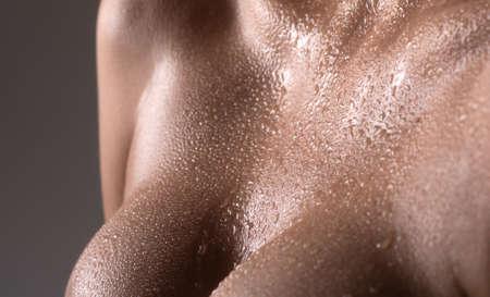 Women with wet breasts. Sexy breas, boobs, sensual beautiful slim female body. Closeup of female boob.