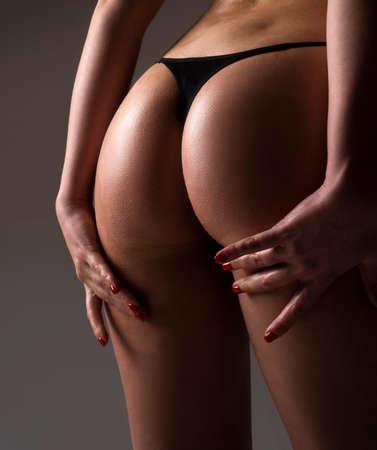 Sexy in lingerie. Perfect Female Buttocks slim figure, bikini thong underwear. Woman silhouette in panties.