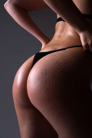 Close up Female Buttocks slim figure, bikini thong underwear.