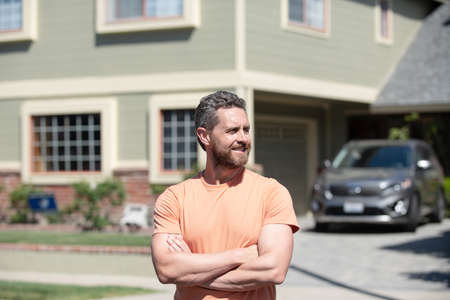 Middle-aged man satisfied with life success. Realtor businessman waiting for visitors.