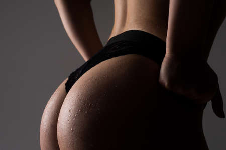 Sexy slim figure, bikini thong underwear. Woman silhouette body in panties. Cropped close up buttocks, big butt.